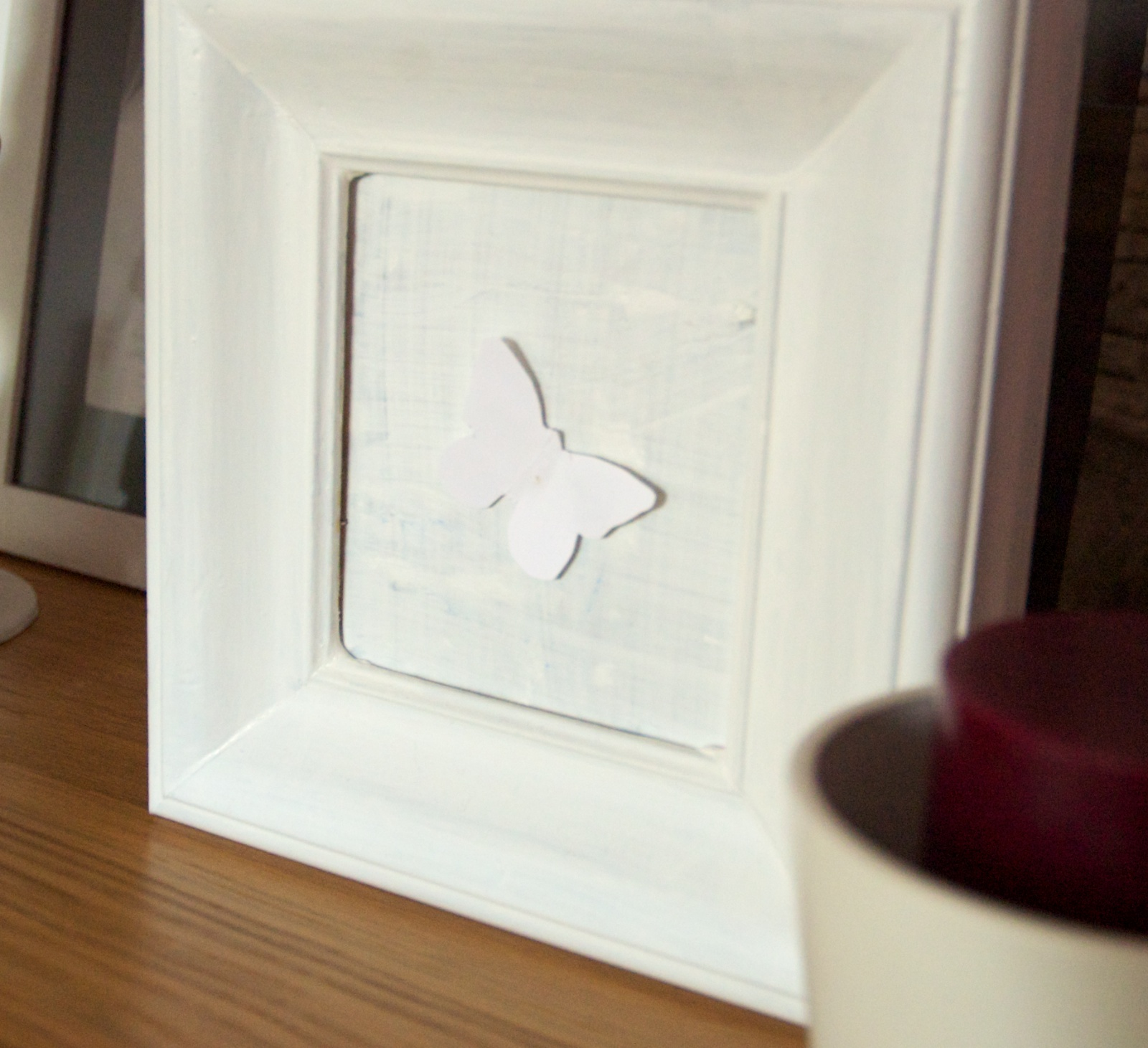 white frame and the butterfly